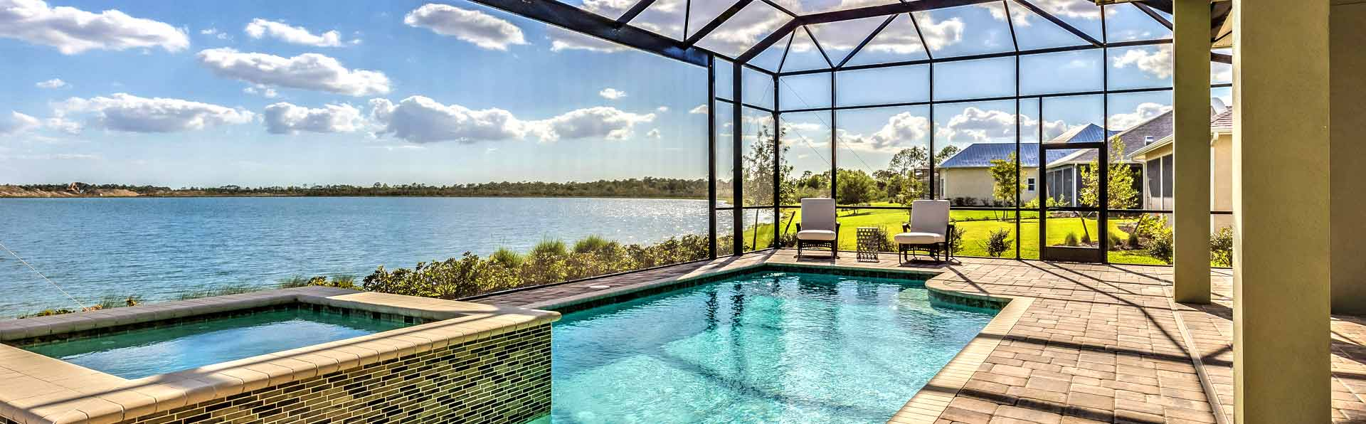 Screened in Swimming Pool overlooking a large lake